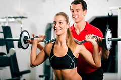 Woman with Personal Trainer in gym (Abu Dhabi Personal Trainers) Tags: gym barbell trainer woman workout exercise exercising fitness couple man strength training coach person people young lift lifting weight power powerful sport sportive muscles muscular health active body bodybuilding attractive beautiful recreation club strengthen adult personal coaching fun help instruction instructor personaltrainer gymnastics powergymnastics fit germany