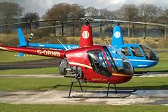 G-ORMB R-22 & G-HYND R-44 (Troonafish) Tags: gormb r22 ghynd r44 heliair heliaircom helicopter helicopters civilaviation civilaircraft pleasureflight charterflight civilian chopper rotorblades cumbernauld cumbernauldairport strathclyde scotland scottish scottishaviation gavintroon gavtroon robinson