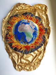 Hot World Surrounded By Tyvek (enovember) Tags: global warming fire heating up earth climate change tyvek gold paint thread map africa