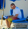 Gentleman contemplating his cap (LarryJay99 ) Tags: male man dude barefoot ilobsterit profile seated atlanticocean hands peekingpits caps beach subtractive floridabeaches blackmale canon60d handsome florida canonefs60mmf28macrousa men arms atlantic urban legs face delraybeach stubble barefeet scruff canonef70300mmf456isusm bulge bulges bulging barfuss