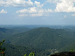 It seems to be nothing but wilderness (debstromquist) Tags: trees mountains clouds kentucky ky fallcolors parks autumnleaves appalachia cumberland cumberlandplateau appalachianmountains latesummer stateparks scenicviews cumberlandmountains kingdomcomestatepark creechoverlook