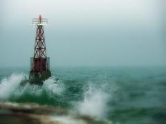 The Ubiquitous Beacon Shot (bjg_snaps) Tags: lighthouse beacon lakemichigan chicago stormy fog foggy rain rainy blur surf waves crashing nature