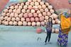 Pottery Pile (peterkelly) Tags: digital canon 6d india asia jaipur rajasthan ceramics ceramic pots pot woman girl pile vendor stall blue yellow dress clay earthenware pottery jugs jug
