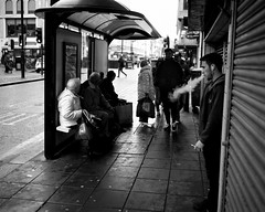 A Busy Bus Stop - Newcastle (Richard James Palmer) Tags: mamiya7ii mamiya 7ii 80mm ilford hp5 ilfordmicrophen microphen ishootfilm shoot film iso 400 iso400 ilfordhp5 f4 newcastle northeast north east street photography streetphotography portrait black white rangefinder medium format 120 filmisnotdead analogue documentary epsonperfectionv700 epson v700 1125 newcastleupontyne upon tyne tyneandwear northern uk england urban melancholy art fineart new overcast isolated walkabout 2016 gritty gloomy abstract trapped blackandwhite monochrome