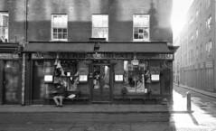 Ye Olde London in the sun (Westhamwolf) Tags: london east city england shop fruit cafe sunlight street bw black white