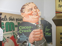 The Taste that Refreshes - Liquid Chocolate Cocoa Crush 0472 (Brechtbug) Tags: the taste that refreshes liquid chocolate cocoa crush cardboard standee ad billboard advertisement 01212017 new york city billboards poster shadows afternoon soda soft drink straw diet can bottle glass milky milk smiling winking man sidney greenstreet type guy 1930s straws sipping