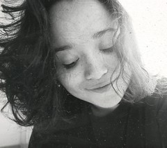 Language is wine upon the lips. (porranenem) Tags: photography blackcolors blackandwhite girl smile analog nikon messyhair grainy grainisgood
