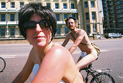 the crazy cupple (lomokev) Tags: people bike canon john brighton mask skin body police bikes sunny yvonne masks cycle fahrrad vlo fiets cycles eos1 circularpolarizer bicicletta fujisuperia400 bicis worldnakedbikeride nakedbikeride thelevel canoneos1 rudebits brightonnakedbikeride brightonworldnakedbikeride upcoming:event=46171 file:name=cnv00004b johnsc flickr:user=yvoluna flickr:nsid=13520439n07