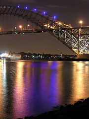 bayonne bridge (nj dodge) Tags: longexposure bridge blue reflection water colors night lights purple listeningto nj bridges statenisland bayonne portrichmond bayonnebridge killvankull simplemindsstreetfightingyears collinspark
