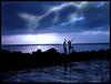 Brincando... (Thiago Lopes) Tags: praia beach rain clouds photoshop raios mar bravo manipulation nuvens noite pedras oceano jovens adolecentes kkfav kkblog