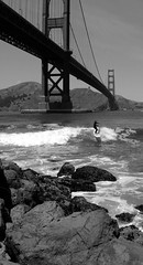 Hangin' 10 Under the Gate (cwgoodroe) Tags: sf sanfrancisco bridge bw water golden gate surf surfer landmark surfing shore goldengate longboard unusual sfchronicle 96hrs sfchronicle96hours sfchronicle96hrs