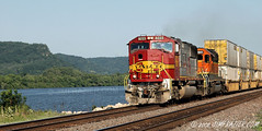 BNSF 8223 and 7841 southbound at Trempealeau, Wisconsin along the Mississippi (Jim Frazier) Tags: road trip railroad red vacation mountains santafe industry water june metal wisconsin train river mississippi vanishingpoint scenery shiny track commerce cityscape power angle diesel v100 tracks engine machine engineering rail railway trains roadtrip 2006 stack business engines transportation rails mississippiriver locomotive f3 bluffs powerful f5 freight bnsf locomotives southbound freighttrain v200 burlingtonnorthern trempealeau burlingtonnorthernsantafe v500 threequarter v1000 q4 7841 8223 stacktrain threequarterangle mississippis e060627c trempeauleaucity2006 trempealeautrains bookmarkprint jimfraziercom wmembed