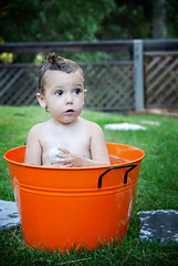 bathtime at dusk in an orange tub in topanga. (sesame ellis) Tags: orange girl outside bath toddler dusk mykid shampoo tub year2 topangacanyon