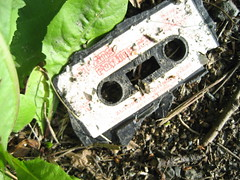 Discarded Transformers Cassette Tape At The Side Of The Road, Clarach Valley, 23-07-06 (DG Jones) Tags: wales retro aberystwyth robots transformers 80s roadside discarded eighties cassette ceredigion cassettetape clarach robotsindisguise outmoded oldtech llangorwen sophtwareslump bestonesdgjones