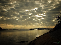 Sunburst through Cloud (Rock Steady Images) Tags: ontario canada canon landscape island is north powershot 100views 200views manitoulin s3 50views potofgold 25views mywinners channellake huronsailing aplusphoto bypaulchambers rocksteadyimages