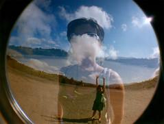 Diana x 2 (DavidGorgojo) Tags: blue sky film beach 35mm lomo lomography doubleexposure toycamera asturias playa fisheye diana cielo 100club navia ojodepez dobleexposición 50club dianabas fvdoubleexposure