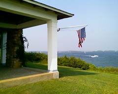 porch and flag over PBN (sita puddin pie) Tags: ocean water bay boat capecod flag lawn porch column narrows pleasantbay pbn greatgrans southorleansma