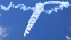 Jurgis Kairys signature... (Michael Kalognomos) Tags: blue sky canon airplane spiral eos airport smoke signature trails athens airshow planes 75300 vapour aerobatics jurgis 2015 kairys tatoi 70d