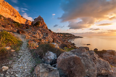 Sluggish (S l a w e k) Tags: morning travel sea seascape tourism nature clouds sunrise dawn bay coast rocks mediterranean natural rocky sunny malta boulders coastal melieha slugsbay