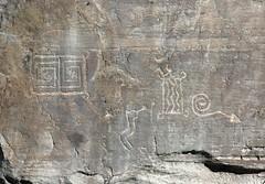 Petroglyphs / Chaco Culture NHP (Ron Wolf) Tags: anasazi anthropology archaeology chacoculturenationalhistoricalpark chacoan nationalpark nativeamerican puebloan anthromorph anthropomorph arrow blanket design geometric panel petroglyph rockart spiral newmexico