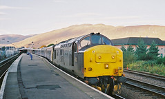37428 Fort William October 2003 (Waddo's World of Railways) Tags: 37 374 railway train engine diesel ee eth eh loco locomotive growler tractor syphon ews class37 class374 west highlands westhighland westhighlands westhighlandline remote sun sunny cloud munro mountain mountains scotland uk hill 1y11 sleeper bedz fortbill fortwilliam edinburgh fortwilliamsleeper edinburghtofortwilliamsleeper edinburghtofortwilliam eustonsleeper euston beds coaches scotrail locohauled class37hauledsleeper ben nevis bennevis terminus fortwilliamstation 428 37428 royalscotsman royalscotsmanlivery rail 2003 autumn october