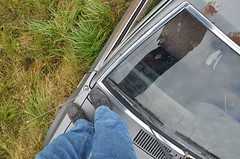walking on cars (mcfcrandall) Tags: car feet legs standing windshield rust roof wipers grass antenna fun mcleans wreck autowreckers junked old abandoned