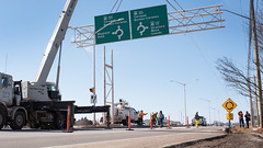 Trans Canada Highway signage installation near Maypoint Plaza (Government of Prince Edward Island) Tags: transcanadahighway tch signage crane roundabout directional