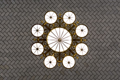 Chandelier V (Jan van der Wolf) Tags: map14196v kroonluchter lamp light ceiling plafond ellisisland nyc newyork tiles tegels pov perspective frogperspective kikvorsperspectief symmetric symmetry symmetrie