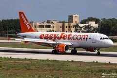 EasyJet --- Airbus A320 --- G-EZUS (Drinu C) Tags: plane aircraft aviation sony airbus dsc easyjet a320 mla gezus lmml hx100v adrianciliaphotography