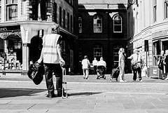 Taking a rest. (Johnbasil1) Tags: street city shadow bw film 35mm newcastle mono pentax k1000 xp2 worker ilford