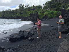 Photos on the black sand beach with John Hugg - guide