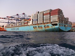 AQABA - Maersk, one of the biggest container shipping companies. (LEO-ONE) Tags: world city sunset red sea people sun beach dead boat lawrence war ship gulf desert flag redsea wwi middleeast mosque east jordan container arab arabia flagpole middle deadsea jordanian aqaba maersk giordania العقبة