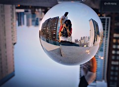 Reflections eternal (cdc1924) Tags: city urban chicago reflection rooftop reflections nikon sitting cityscape upsidedown depthoffield ledge refraction perch crystalball selfie urbanview chicagoans outdoorphotography
