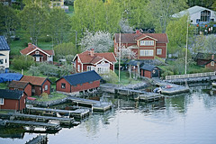 Boat Houses (Herculeus.) Tags: houses reflection docks fence boats outside coast sweden outdoor barns shoreline fences business residences 2015 boathouses landscapeorientation 5photosaday architectureinpixels blossomingtrees