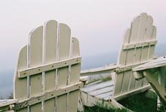 White Chairs (Rachael.Robinson) Tags: ocean white canada color film beach nature grass 35mm outside outdoors island wooden chair view maine campobello colorfilm
