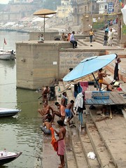 india (gerben more) Tags: shirtless people india umbrella river boat parasol varanasi ritual bathing washing ganga ganges ghats benares ghat