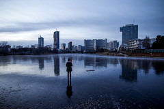 Frozen (CoolMcFlash) Tags: frozen winter cold skyline cityscape vienna austria kaisermühlen altedonau kaiserwasser water person woman standing canon eos 60d sigma 1020mm 35 donaucity dc architecture modern building reflection gefroren kalt stadt stadtlandschaft wien österreich danube wasser frau stehen architektur gebäude spiegelung fotografie photography