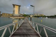 Walkway to Darwin Waterfront (NettyA) Tags: australia darwin nt northernterritory city wetseason darwinwaterfront walkway buildings apartments water leadinglines clouds path people