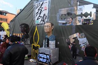 Seoul Korea Kwanghwamun candle rally February 17 2017 featuring effigies and reflections -