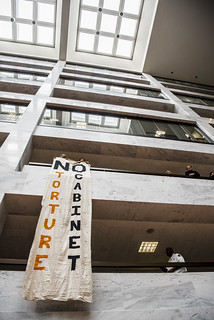 Members of Witness Against Torture Hold a Banner Protesting Pro-Torture Members of Donald Trump's Cabinet