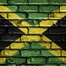National Flag of Jamaica on a Brick Wall