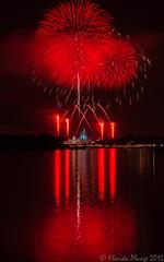 RED FIREWORKS AND REFLECTION (floridaplunge) Tags: red reflection castle water night outside orlando florida fireworks disney disneyworld wishes burst waltdisneyworld pyro magickingdom mvmcp holidaywishes
