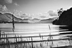 Grasses of Ullswater (B+W) (ben_thedriver) Tags: old autumn sunset summer england blackandwhite orange cloud sun colour reflection green film water grass rock clouds contrast canon walking landscape eos mirror golden landscapes early high still woods rocks warm raw quiet ripple lakedistrict sigma hills clear filter lee bleak rest grad vignette goldenhour filmic waterscape constant ullswater filmlook constantlight ndgradfilter eos60d