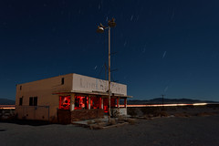 open all night. ludlow, ca. 2014. (eyetwist) Tags: california old longexposure light red food lightpainting abandoned film sign night america dark painting movie landscape typography photography star cafe route66 nikon long exposure desert empty ruin trails diner headlights location 66 gone historic ludlow fullmoon route faded highdesert mojave type americana moonlight trucks lonely interstate lighttrails 40 nikkor streaks bradpitt derelict nocturne burned taillights vandals startrails mojavedesert gutted polaris typographic northstar vandalized eyetwist ludlowcafe npy 1024mm d7000 capturenx2 eyetwistkevinballuff 1024mmf3545g americantypology