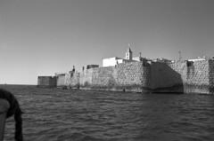 Acre - Old City (Ilya.Bur) Tags: acre old city israel nikon fe sigma 28mm f28 adox silvermax 100 caffenolcl analog film bw black white עכו wall fortress sea mediterranian