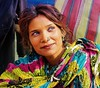The colorful lady (Sayanti Deb) Tags: people portrait street india kolkata face candid eye colors sankranti gangasagar sagarmelatransitcamp babughat festival