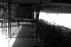 Chicago Grid (KevinIrvineChi) Tags: fire escape grid bnw blackwhite bw chicago chicagoist hydepark southside del prado hampton house condo condominium sunny sky bleached brick bricked wall walls up lookingup metal vanishing point sony dscrx100 abstract windows sun alley