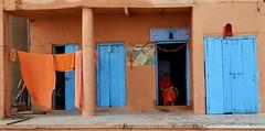 Orange and Blue (Alex L'aventurier,) Tags: varanasi india inde uttarpradesh benares banaras kashi orange clothes drying doors portes bleu blue facade urban urbain house maison living life hindu