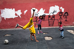Fun. Istanbul, Turkey (Marji Lang Photography) Tags: street city travel colors wall kids turkey children fun outdoors three football play upsidedown roman country balloon citylife streetphotography photojournalism documentary streetlife istanbul turquie photograph silkroad acrobat ottoman handstands havefun turkish bosphorus cultural turk eurasia marmara streetshot goldenhorn transcontinental kidos travelphotography turkeytrip agglomeration threekids turkishempire ottomanempire travelinturkey kidslife photodocumentary southeasterneurope turkishculture globalcity europeandasia westernasia visitistanbul visitturkey lygos ottomancaliphate turkeytourism istanbulmetropolitanmunicipality marjilang heartofturkey