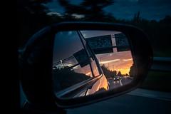 Rear Window Sunrise  (Un coup d'oeil dans le rtro) (Gilderic Photography) Tags: road light sun reflection car speed sunrise lumix mirror highway belgium belgique belgie lumire voiture panasonic reflet rearwindow autoroute rtroviseur aube gilderic lx3 dmclx3